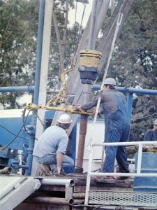 Ruffnecks make a connection (add pipe) on an air drilled well in the Arkoma, circa 1980s